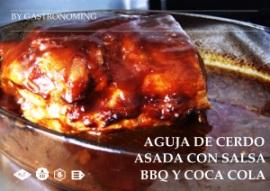 Aguja de cerdo asada con salsa bbq y coca cola